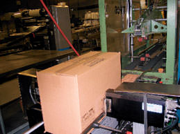 Installed on a main packaging line that packs about 300 items/min, the new ink-jet printer is used with about 20 different shipping case sizes. Mounted on opposing sides of a main packaging line are two 4-in. printheads.